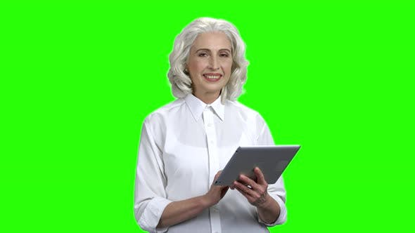 Elegant Senior Woman Holding Digital Tablet
