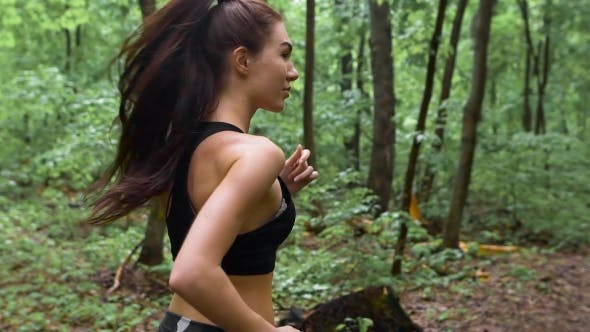 Thumbnail for Young Athletic Sporty Girl With Long Hair Training In Green Forest