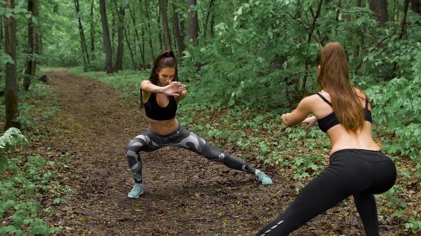 Thumbnail for Two Slender Fitness Girl In The Forest.