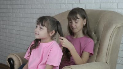 Combing the Hair of a Child.