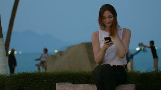 Thumbnail for Girl Laughing Using Smartphone Device