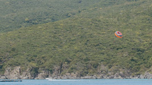 Thumbnail for Tourists Sailing on Parachute above the Sea