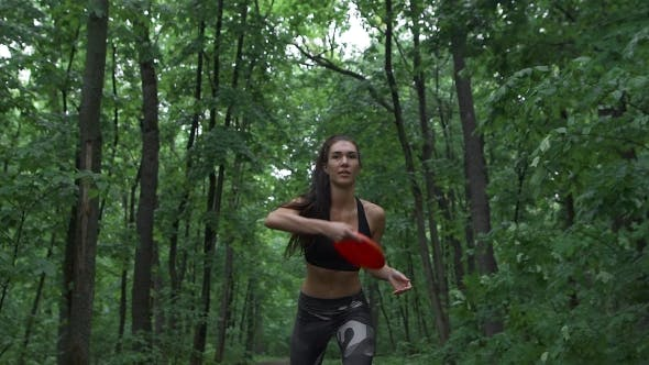 Thumbnail for The Slender Fitness Girl Playing With Someone With a Frisbee