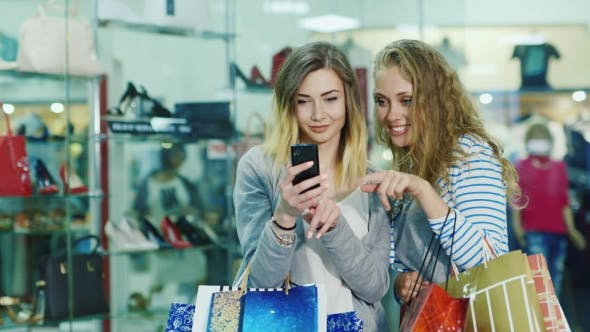 Thumbnail for Two Attractive Woman Looking At The Photos On The Phone