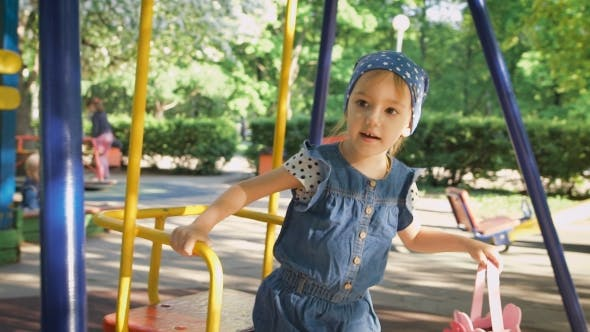 Thumbnail for Little Girl On a Playground. Child Playing Outdoors In Summer. Children Having Fun