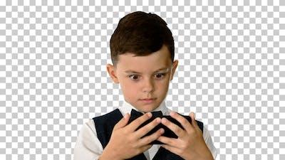 Little boy in waistcoat watching something, Alpha Channel