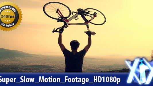 Biker Lifting His Bike