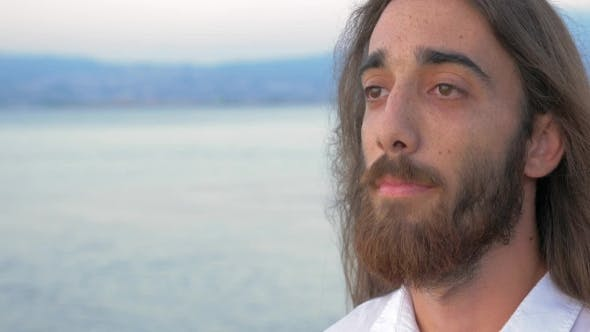 Thumbnail for Man With Long Hair And Beard On Sea Background