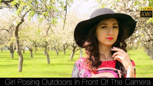 Cover Image for Girl Posing Outdoors In Front Of The Camera 4