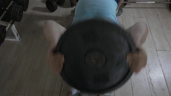 Thumbnail for Senior Man Working Out With Weight Disk