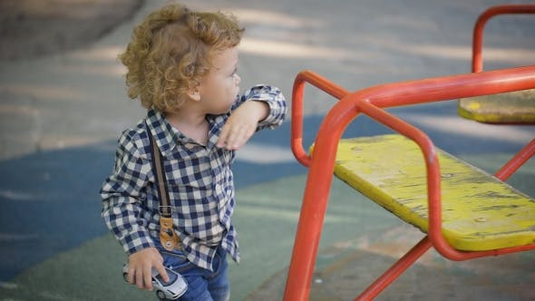 Thumbnail for Happy Little Boy Playing On The Playground. He Is Very Cute And Naive.