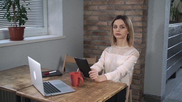 Thumbnail for Attractive Woman Making a Video Call By Tablet.