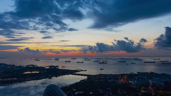 Time Lapse shot a beautiful sunrise and hundreds of cargo ships anchored off the coast of Singapore.