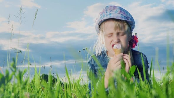 Thumbnail for Funny Girl Eating Ice Cream Outdoors