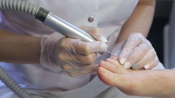 Thumbnail for Woman Gets a Pedicure Procedure In Spa Salon