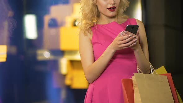 Thumbnail for Female Shopaholic Checking Prices of Her Purchases at Online Stores Mobile App