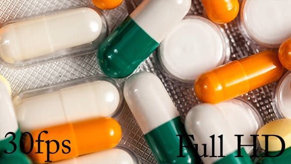 Many Pills And Capsules On Table