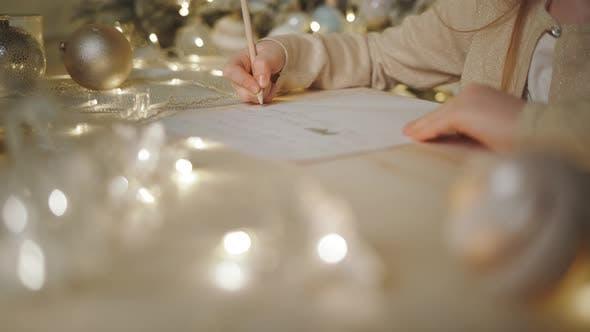 Thumbnail for Girl Writes a Letter To Santa Claus