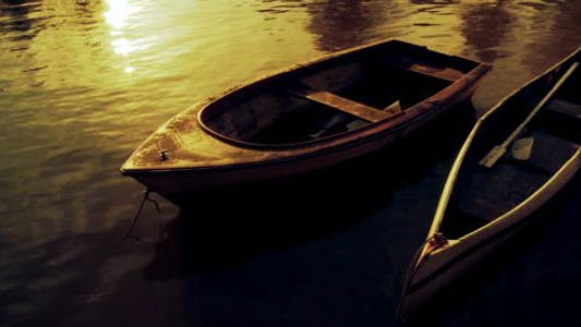 Thumbnail for Canoes On the Lake at Sunset.