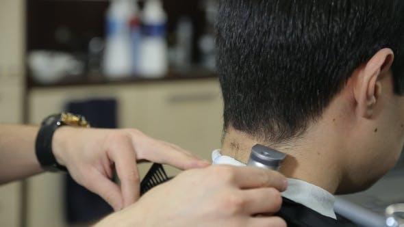 Thumbnail for Man Hairdresser Doing Haircut In Hair Salon