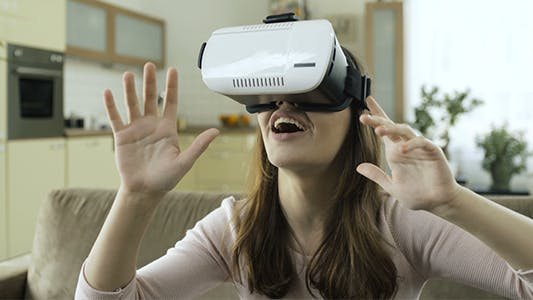 Cover Image for Woman Using VR Goggles Device For Mobiles