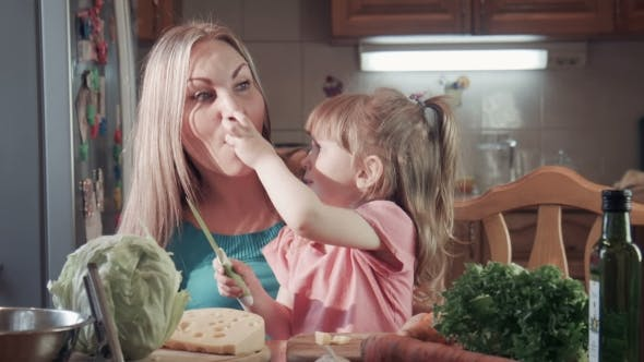 Thumbnail for Girl Cutting Cheese And Feeding Her Mother