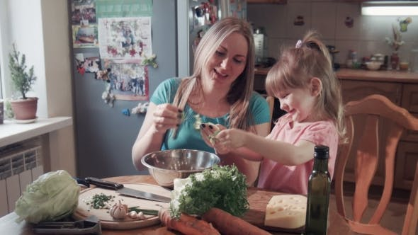 Thumbnail for Girl And Mom Tearing Salad In Bowl
