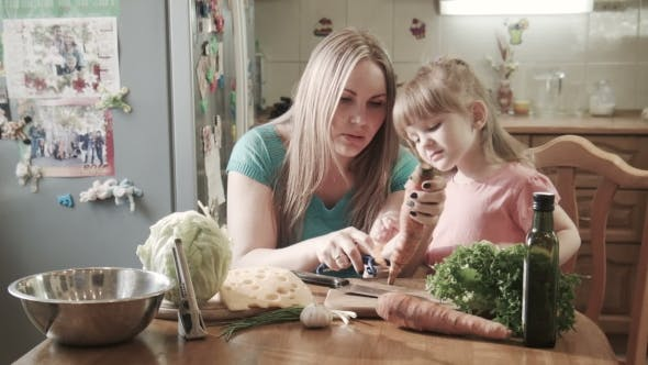 Thumbnail for Mother Peeling Carrot With Daughter