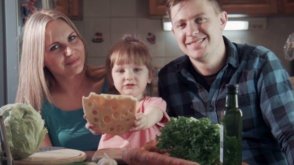 Thumbnail for Family Biting Tasting Cheese And Smiling At Camera