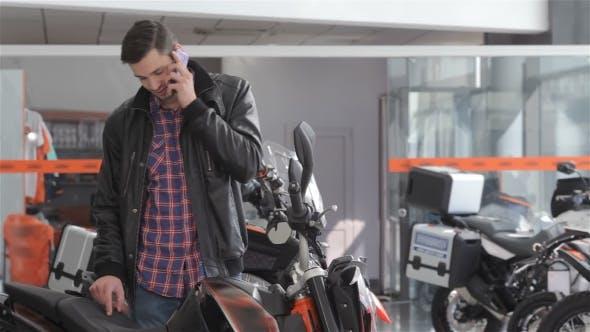 Thumbnail for Talks On The Phone Near Motorbike