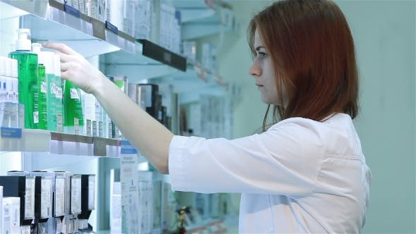 Thumbnail for Woman Standing In Pharmacy Drugstore