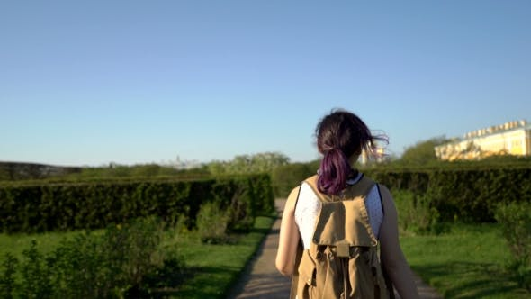 Thumbnail for Tourist Girl Enjoying Beautiful Park