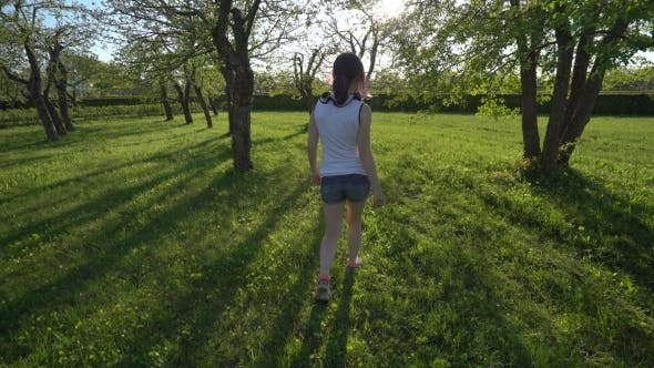 Cover Image for Girl Walking In The Park In Spring