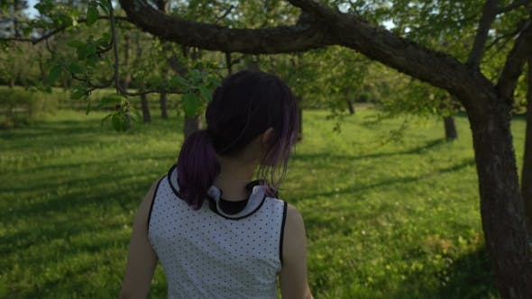 Thumbnail for Happy Young Girl Hides Behind Trees