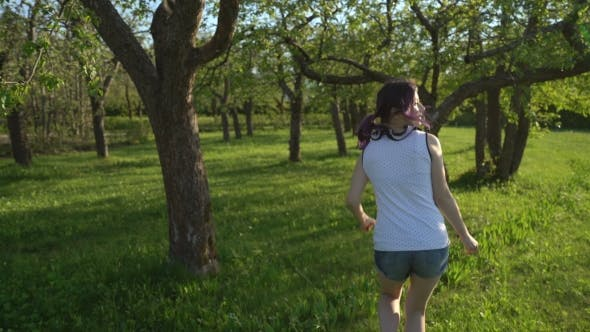 Thumbnail for Happy Young Girl Hides Behind a Tree