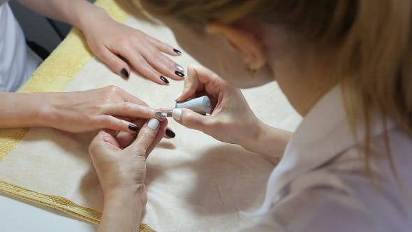 Thumbnail for Woman Gets a Manicure Procedure In Spa Salon
