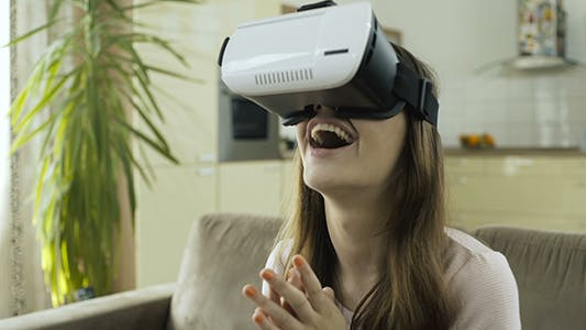 Thumbnail for Girl Explores Virtual Reality