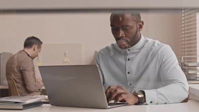 African Man Working on Computer