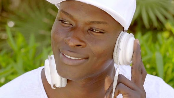 Thumbnail for Attractive African Man Listening To Music