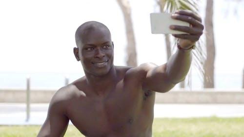 Of Shirtless Black Man With Phone