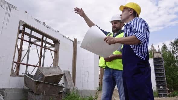 Thumbnail for Two Men Working at Construction Site