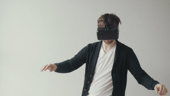 Thumbnail for Man Using The Virtual Reality Headset, Doing Movements, Skateboard Imitation