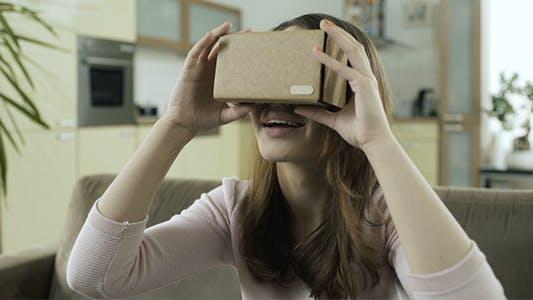 Thumbnail for Girl Trying Cardboard VR Headset