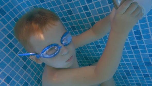 Thumbnail for Boy In Goggles Holding Breath In Swimming Pool