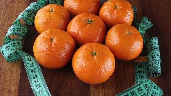 Thumbnail for Mandarine und Maßband Drehen 1
