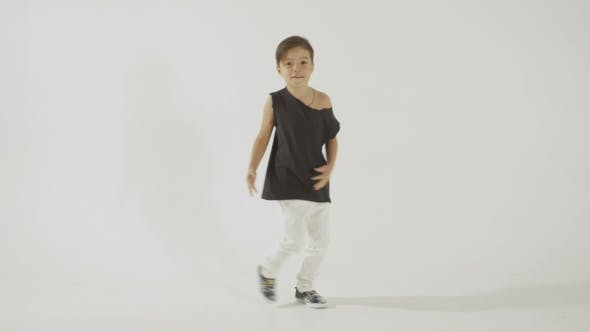 Thumbnail for Stylish Little Boy In Black T-Shirt Dancing And Having Fun