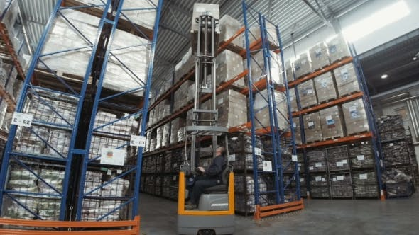 Thumbnail for Forklift Truck Driver Unloading Pallet In Storage Warehouse