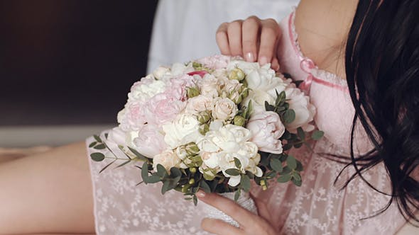 Thumbnail for Happy Bride Holding Bouquet Of Flowers