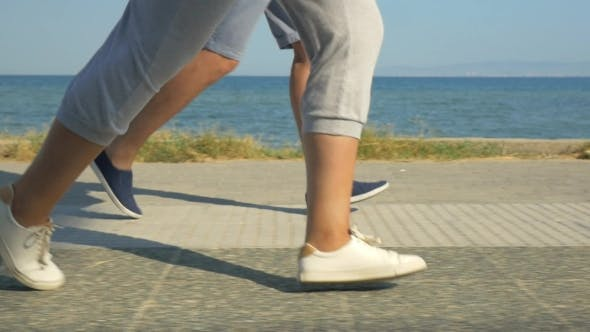 Thumbnail for Legs Of Two Running People