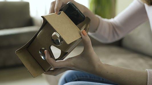 Thumbnail for Girl Set Up Cardboard VR Headset